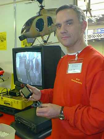 Graham Smith of Radio Controlled Developments shows Heli Cam video transmitter/receiver. The monitor shows the view from the nose of the helicopter.