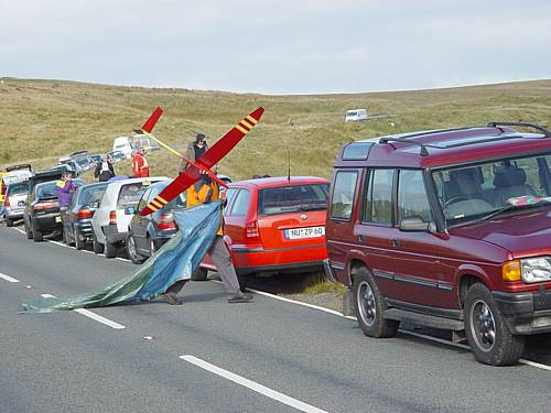 Just part of the line of cars which stretched from North to South Wales That's Ulrich Hauser crossing the road, with his Mirage and rain sheet.