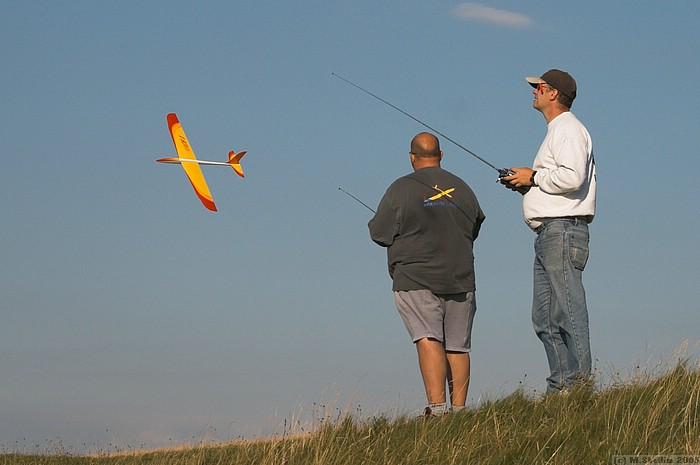 Andy (left) low passing his Mach One during sport flying. Model sports wingerons for super fast rolls.