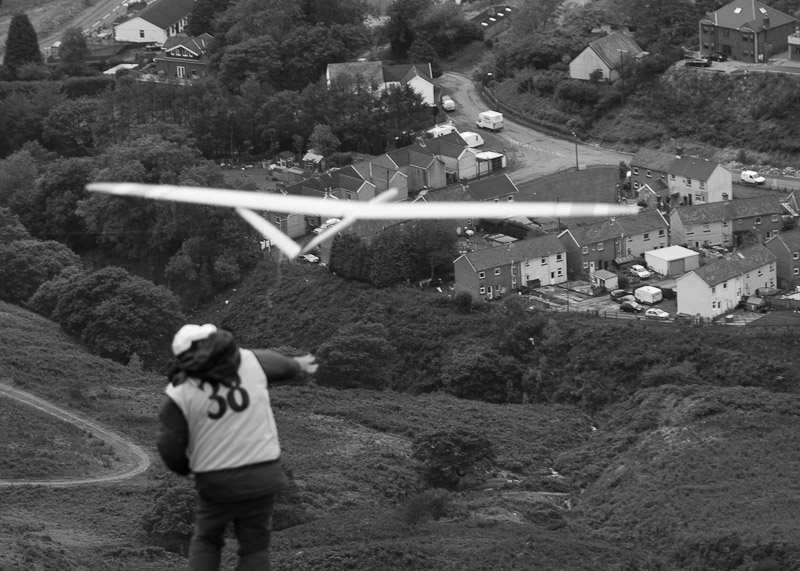John Bennett took this one of me launching, but the camera was more interested in Nanty Moel below!