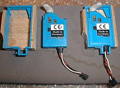Wing servos mounted in boxes